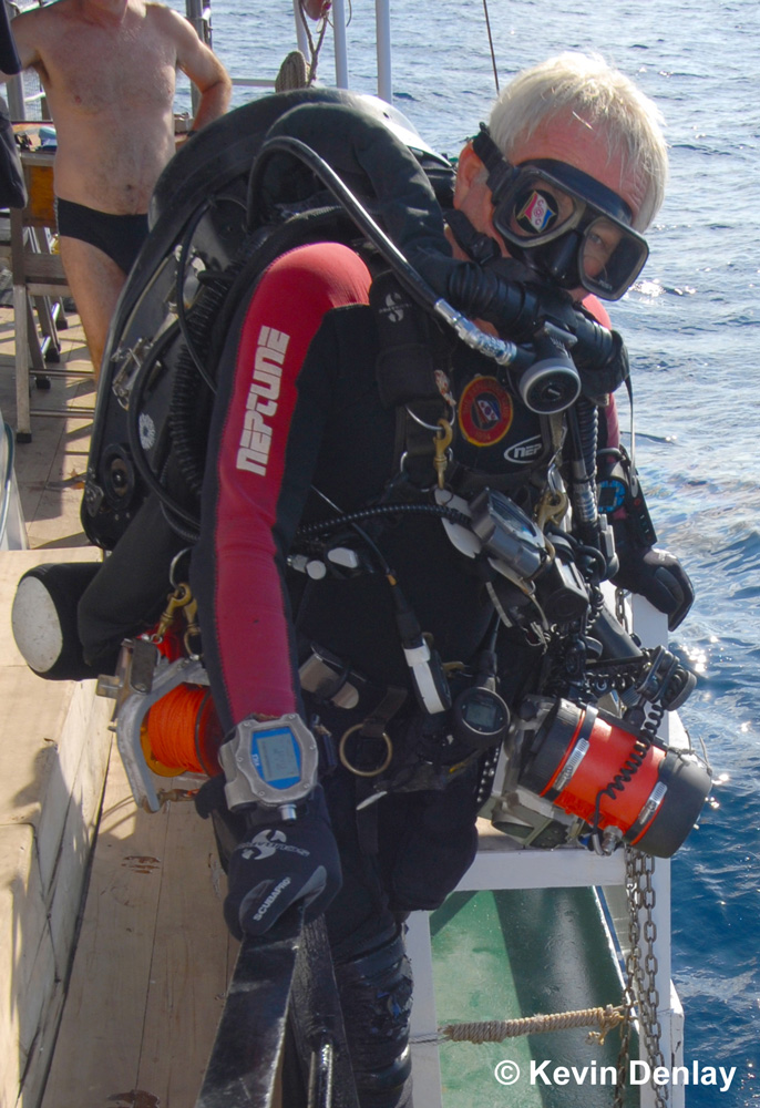 Kevin Denlay, underwater camera attached and using a closed circuit rebreather, about to make a survey dive on the wreck of HMS Exeter.