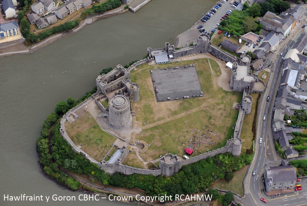 An aerial view of Pembroke Castle shows clear parchmarks in the grass. Crown Copyright RCAHMW, AP_2013_5162.