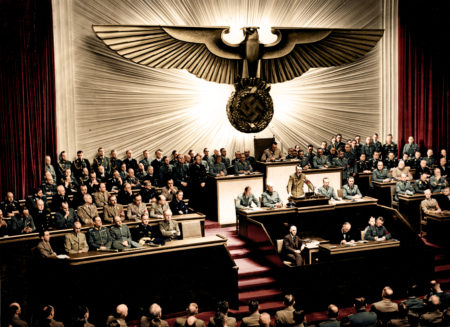 Hitler declares war on the United States. Photographed by unknown at the Kroll Opera House, Berlin, on December 11th 1941, image courtesy of Maritime Magason Historie / Das Bundesarchiv Colourised by Mads Madsen and featured in Retrographic.